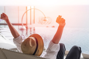 .Good life and easy relax business man lifestyle after work at hotel sitting hands up stretching for happy businessmen people.Simplify Your Life Week