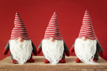 three Christmas gnomes with white beards