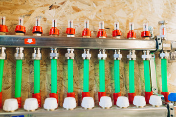 underfloor heating manifold collector with pipes