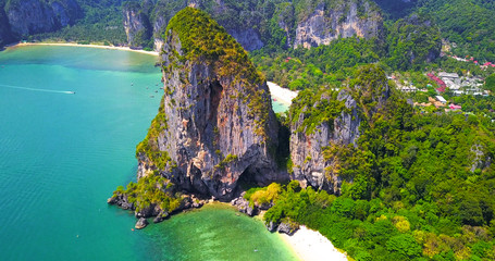 Isolated Tropical Islands With Lush Greenery Surrounded by Turquoise Ocean Water with Boats Moored Off Coast - Aerial Overhead View - Thailand