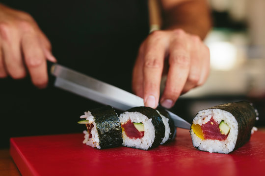 Man cutting fresh sushi