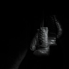 Wall Mural - old boxing gloves on a black background
