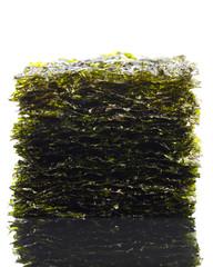 dried nori seaweed laminaria sheets, isolated on white