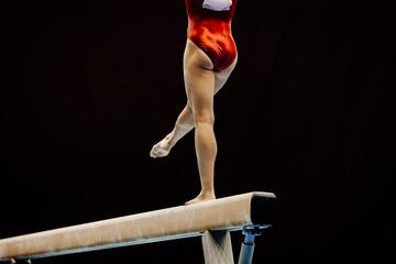 Door stickers Gymnastics legs of female gymnast on balance beam at gymnastics championship