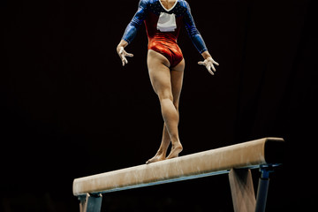 Door stickers Gymnastics performance female gymnast on balance beam on black background