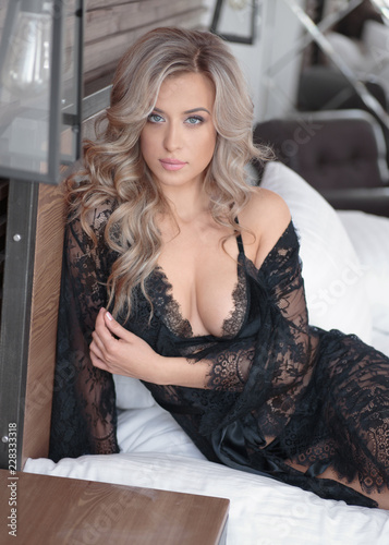 90668339e Sexy blonde in black lingerie on a white bed with a gorgeous body ...