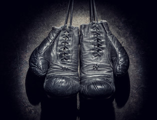 Wall Mural - old boxing gloves on a dark background
