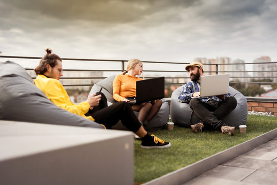 Business people communication, office teamwork. 30 years old people on roof coworking area.