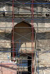 An Egyptian worker carries out restoration work on the wall of al-Zahir Baybars Mosque, an architectural landmark in old Cairo