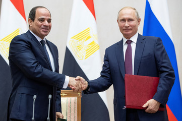 Russian President Putin and Egyptian President al-Sisi shake hands during a signing ceremony following their meeting in Sochi