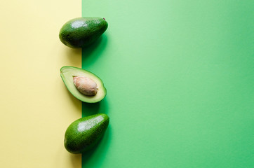 Organic avocado on color background