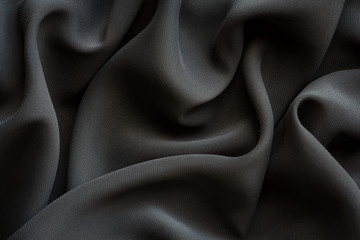 black fabric with large folds,  abstract background
