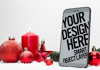 Smartphone near Holiday Decorations Mockup