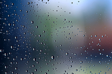 gray wet background / raindrops to overlay on the window, weather, background drops of water rain on the glass transparent