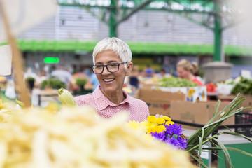 Senior woman on green market