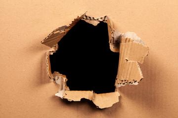 Fotoväggar - Cardboard with a hole - black background