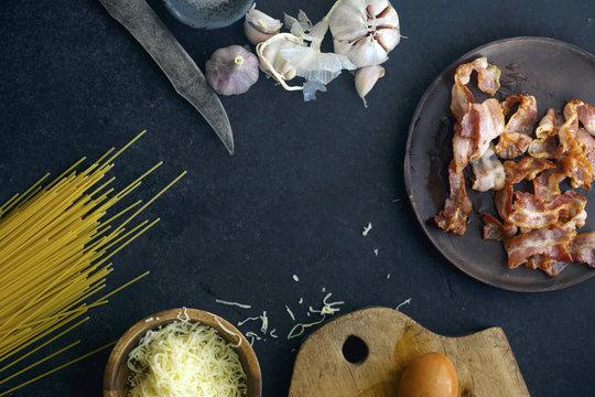 Carbonara pasta ingretients: eggs, garlic, bacon, cheese