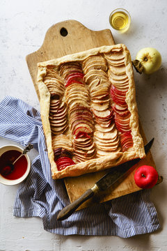Apple galette with tahini frangipane and hibiscus glaze. Fall comfort food concept