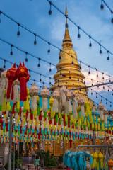 Golden pagoda at Wat Phra That Haripunchai Lamphun with Thai lanna lantern at night .