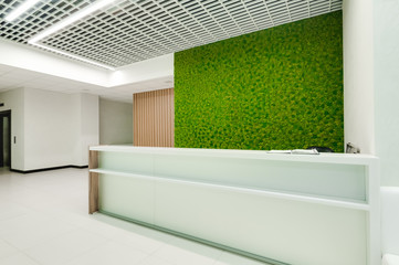 Russia, Novosibirsk - August 16, 2018: decorative moss for interior decoration. office style, interior design elements