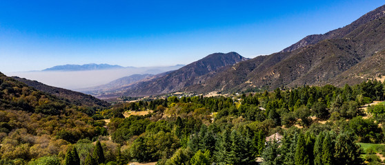 Aerial, drone view of Oak Glen located between the San Bernardino Mountains and Little San...