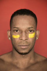 Portrait of black man with yellow paint