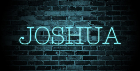 first name Joshua in blue neon on brick wall