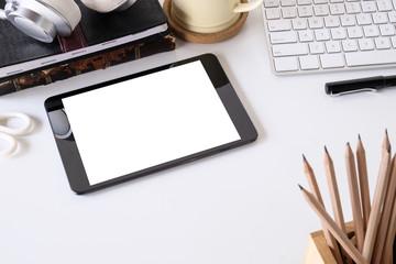 Mockup digital tablet on working office desk.