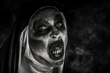 frightening evil nun with bloody teeth. Wall mural