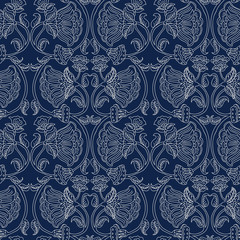 Woodblock printed indigo dye seamless ethnic floral pattern. Traditional oriental garland ornament of India, wave line of flowers and leaves,  ecru on navy blue background. Textile design.