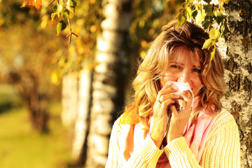 Mature woman with handkerchief and cold outdoor