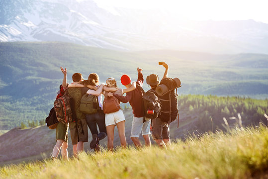 Happy tourists friends making selfie in mountains area