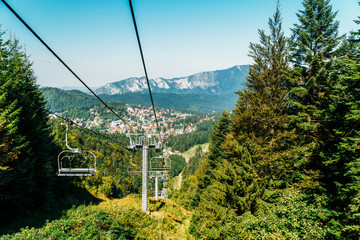 Cable Car Travel In Summer Above Carpathian Mountains In Skiing Resort Of Busteni, Romania