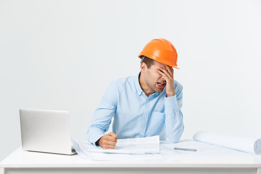 Young workman annoyed angry in furious gesture. Negative expression on white grey background