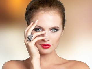 Portrait of beautiful young woman with    make-up and ring