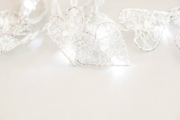 White background with a burning Christmas garland. Copy space.