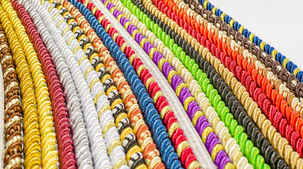 Multicolored ropes laid nearby, colored background, textiles