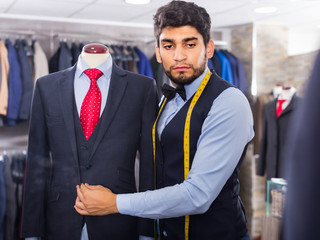 Fashion designer is creating business image with red tie