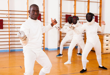 Sporty african american man fencer practicing effective fencing techniques