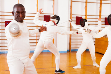 African american man fencer in training room