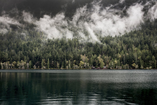 PNW lake with wispy clouds and trees