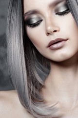 Young beautiful girl with silver make-up and ash hair