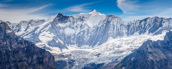 Great view of the massive rock in snow sunlight. Location Swiss alps, Grindelwald valley.