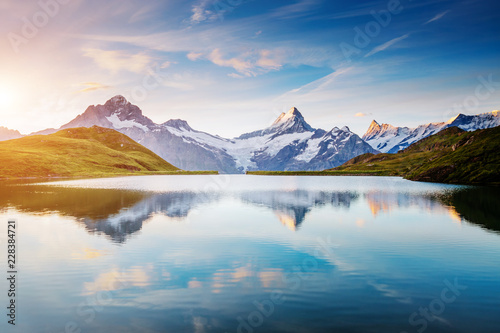 Wall mural Great view of the snow rocky massif. Location Bachalpsee in Swiss alps, Grindelwald valley.