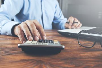 man hand calculator with  keyboard