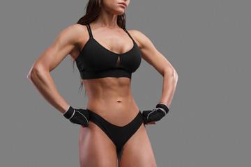 Crop muscular woman in underwear