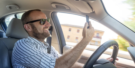 Dangerous man driving with his mobile phone
