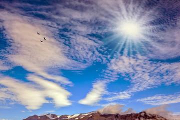 Cool northern sun illuminates the mountains