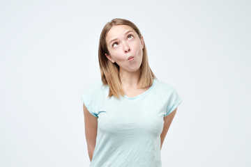 Gorgeous caucasian woman pretends to be kissing doing fish face