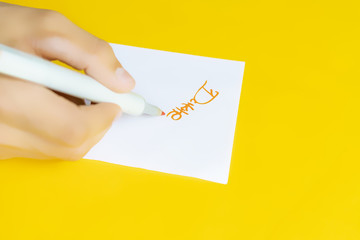 celebrity hand giving the autograph signature isolated on yellow, minimalist creative concept g